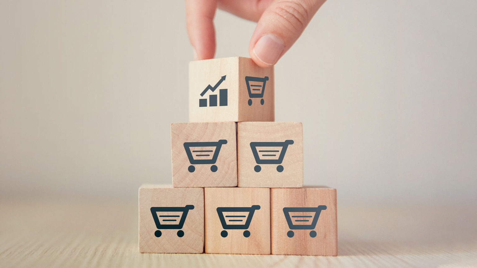 person stacking up blocks representing the 10 amazon fba tips